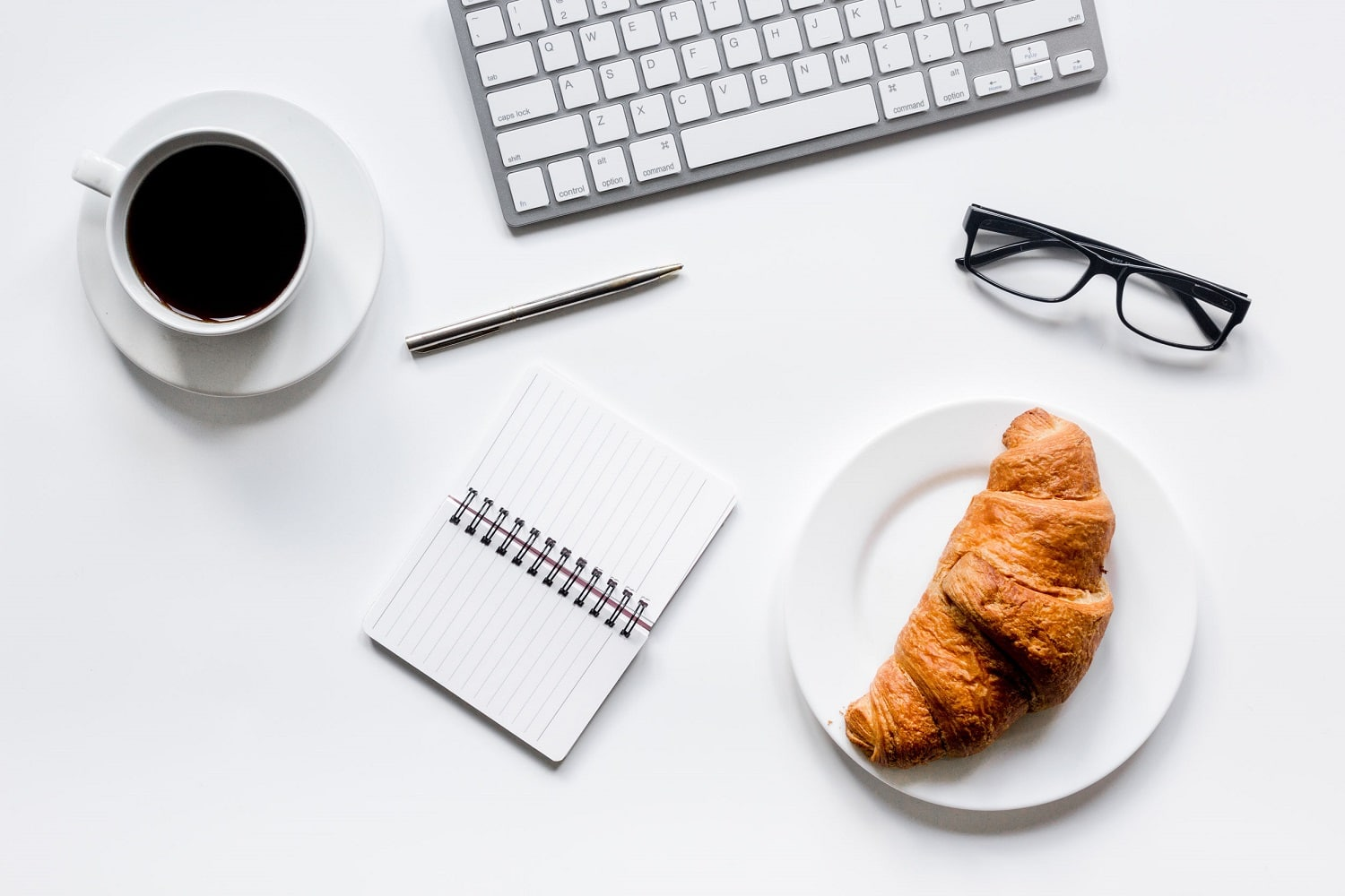 coffee and croissant for breakfast of businessman white office desk background top view space for text